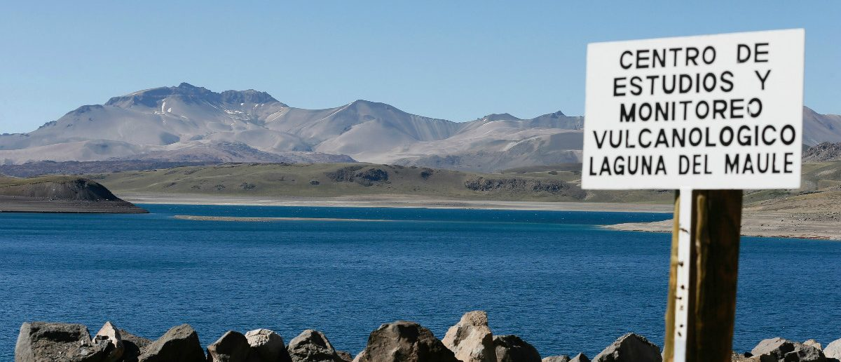 """The Laguna del Maule (Lagoon of Maule) is seen in the VII region of Talca, south of Santiago, Chile November 29, 2016. The sign reads, """"Center of monitoring and volcanological studies, Laguna del Maule"""". REUTERS/Rodrigo Garrido"""