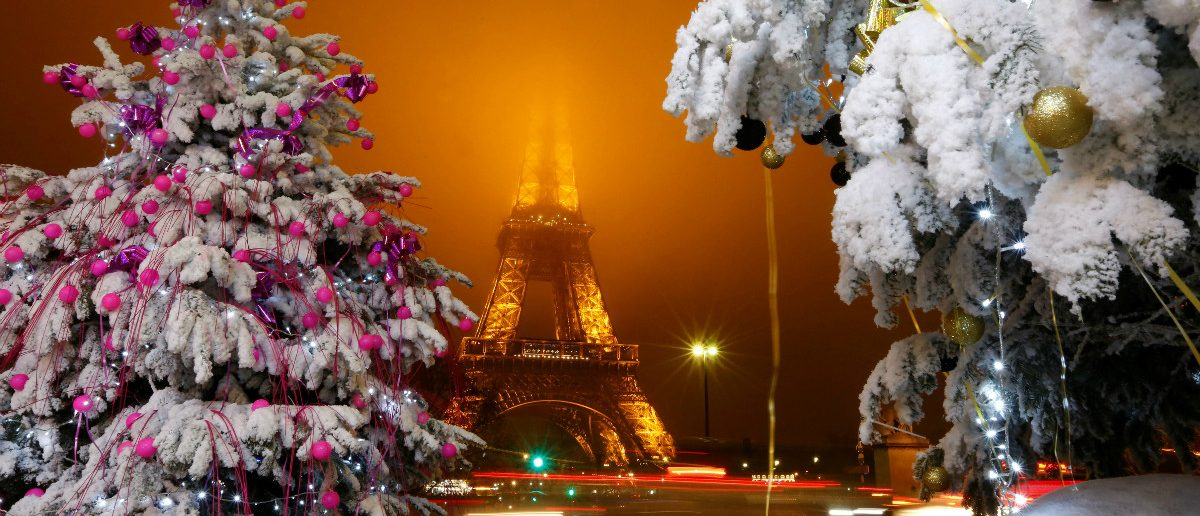 Christmas decorations are seen near the Eiffel Tower in the French capital of Paris, France, December 18, 2016. REUTERS/Jacky Naegelen