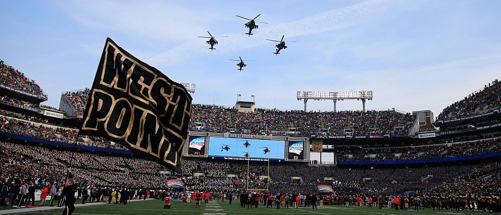 Military helicopters perform a flyover before the start of the Army Black Knights and Navy Midshipmen game at M&T Bank Stadium on December 13, 2014 in Baltimore, Maryland. (Photo by Rob Carr/Getty Images)