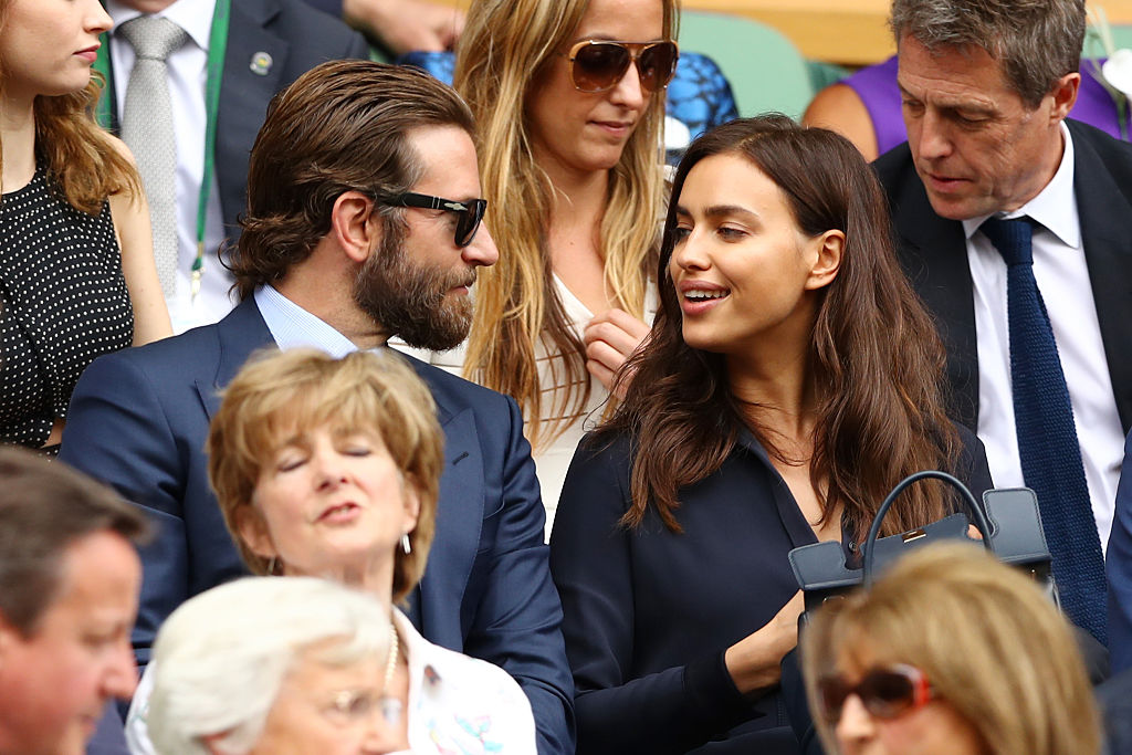 Bradley Cooper and Irina Shayk look on prior to the Men's Singles Final match between Andy Murray of Great Britain and Milos Raonic of Canada on day thirteen of the Wimbledon Lawn Tennis Championships at the All England Lawn Tennis and Croquet Club on July 10, 2016 in London, England. (Photo by Julian Finney/Getty Images)