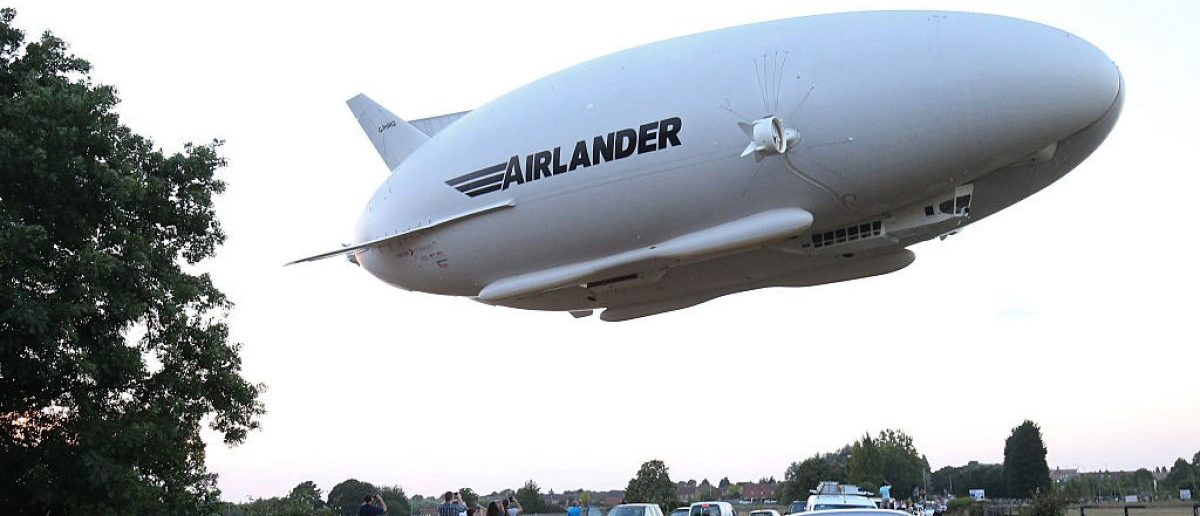 This hybrid airship is seen in the air over a road on its maiden flight from Cardington Airfield near Bedford, north of London, on August 17, 2016. [Photo credit should: JUSTIN TALLIS/AFP/Getty Images]