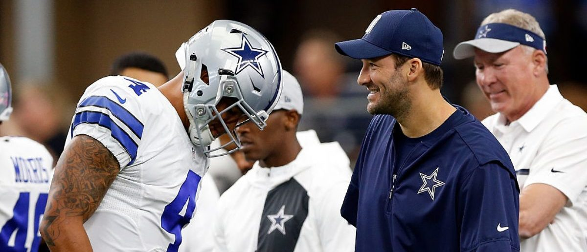 Dak Prescott #4, quarterback of the Dallas Cowboys talks with injured quarterback Tony Romo #8 prior to the game against the Cincinnati Bengals at AT&T Stadium on October 9, 2016 in Arlington, Texas. (Photo by Wesley Hitt/Getty Images)