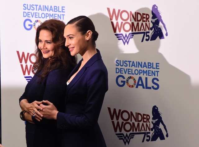 Actors Gal Gadot (R) and Lynda Carter pose as the UN names the comic character Wonder Woman its Honorary Ambassador for the Empowerment of Women and Girls during a ceremony at the United Nations Economic and Social Council Chamber on October 21, 2016, in New York. Gadot played Wonder Woman in recent films, while Carter portrayed the character on television in the 1970s. The honorary title comes as Wonder Woman turns 75 years old. / AFP / TIMOTHY A. CLARY (Photo credit should read TIMOTHY A. CLARY/AFP/Getty Images)
