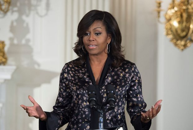 First lady Michelle Obama delivers remarks to middle school, high school and college students from across the country as part of the ongoing series of The GRAMMY Museum musical workshops, at the White House on October 21, 2016, in Washington, D.C. (MOLLY RILEY/AFP/Getty Images)