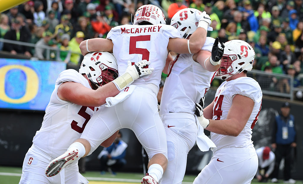 Christian McCaffrey #5 of the Stanford Cardinal celebrates with teammates after scoring a touchdown during the first quarter of the game against the Oregon Ducks at Autzen Stadium on November 12, 2016 in Eugene, Oregon. (Photo by Steve Dykes/Getty Images)