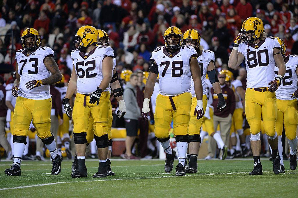 LINCOLN, NE - NOVEMBER 12: The Minnesota Golden Gophers offense led by offensive lineman Donnell Greene #73 and offensive lineman Jared Weyler #62 and offensive lineman Garrison Wright #78 and tight end Nate Wozniak #80 take the field against the Nebraska Cornhuskers at Memorial Stadium on November 12, 2016 in Lincoln, Nebraska. Nebraska defeated Minnesota 24-17. (Photo by Steven Branscombe/Getty Images)