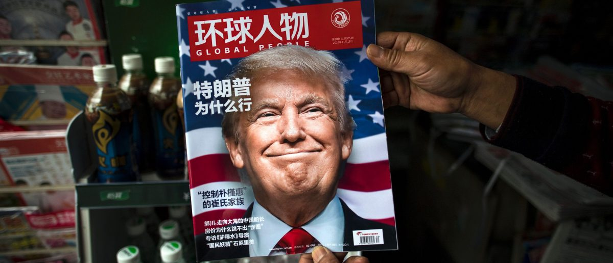 "A copy of the local Chinese magazine Global People with a cover story that translates to ""Why did Trump win?"" JOHANNES EISELE/AFP/Getty Images."