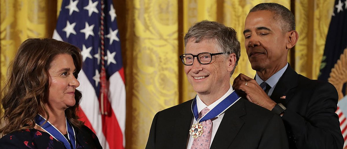 WASHINGTON, DC - NOVEMBER 22: U.S. President Barack Obama (R) awards the Presidential Medal of Freedom to Microsoft founder Bill Gates (C) and his wife Melinda Gates (L), who have donated billions of dollars globally to promote health and fight poverty, during a ceremony in the East Room of the White House. (Photo by Chip Somodevilla/Getty Images)