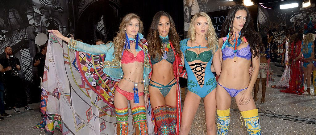 (L-R) Gigi Hadid, Joan Smalls, Lily Donaldson and Adriana Lima poses backstage during the Victoria's Secret Fashion Show on November 30, 2016 in Paris, France. (Photo by Dominique Charriau/Getty Images for Victoria's Secret)