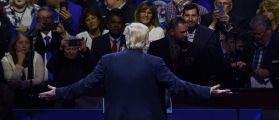President-elect Donald Trump greets teh audience during the USA Thank You Tour at the US Bank Arena in Cincinnati, Ohio on December 1, 2016. / AFP / TIMOTHY A. CLARY