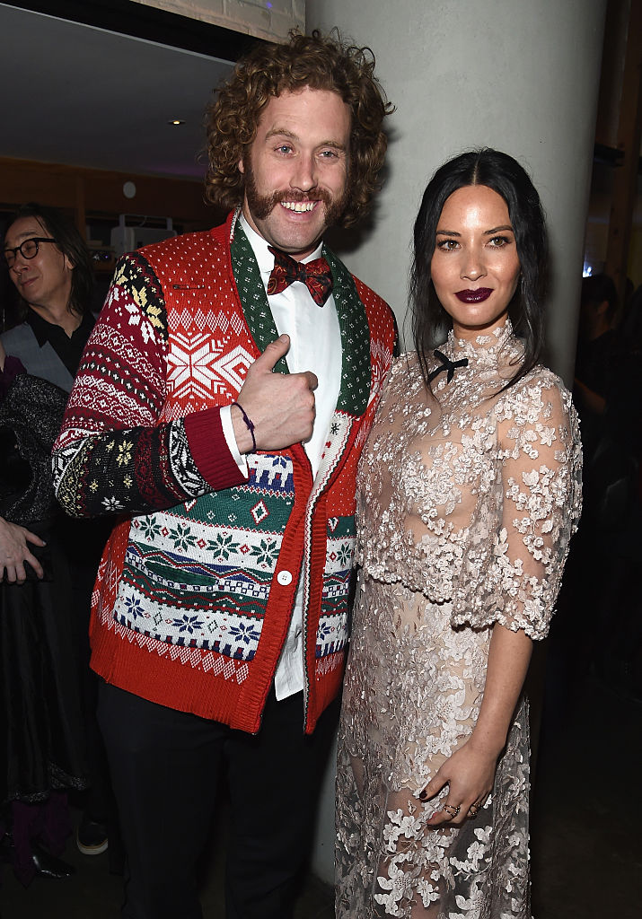 "T. J. Miller and ""Office Christmas Party"" co-star Olivia Munn (Photo by Jamie McCarthy/Getty Images)"