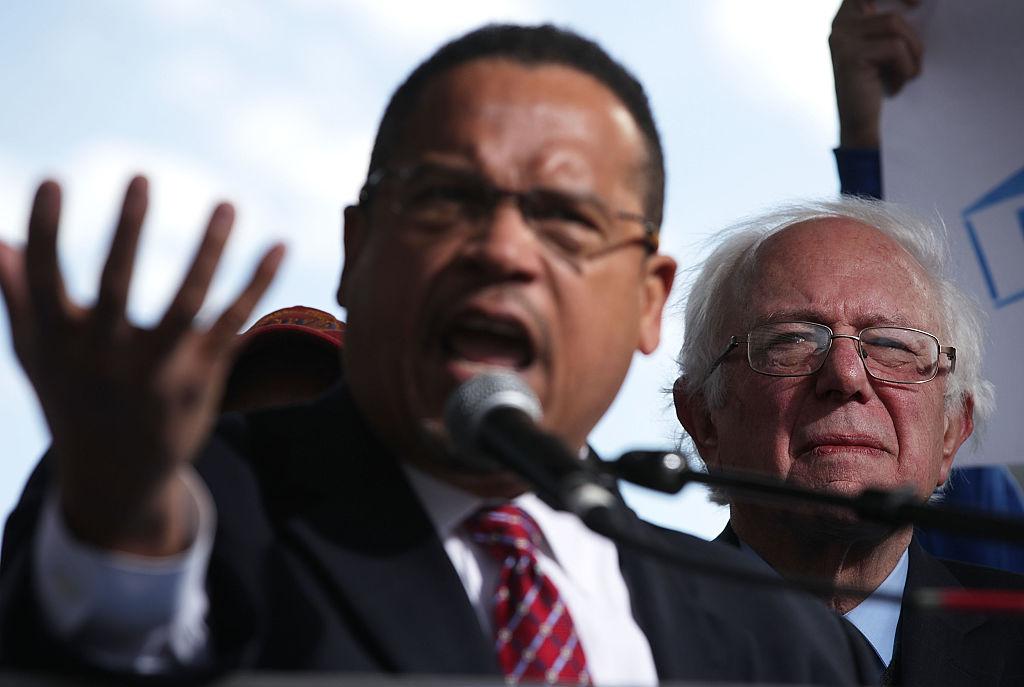 Bernie Sanders looks on as Keith Ellison speaks during a rally on jobs on December 7, 2016 (Getty Images)