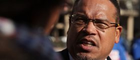 Keith Ellison speaks to a reporter during a rally on jobs on December 7, 2016 at Freedom Plaza in Washington, DC (Getty Images)