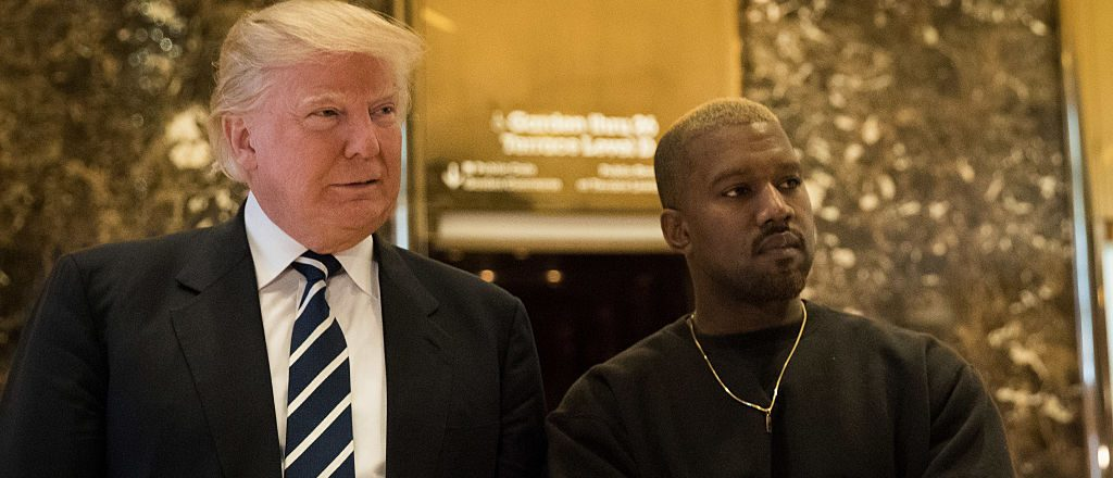 President-elect Donald Trump and Kanye West stand together in the lobby at Trump Tower, December 13, 2016 in New York City. (Photo by Drew Angerer/Getty Images)