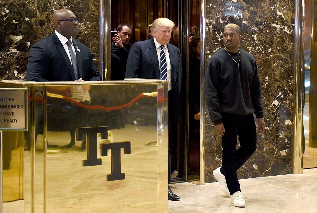 Singer Kanye West and President-elect Donald Trump arrive to speak with the press after their meetings at Trump Tower December 13, 2016 in New York. (Photo credit: TIMOTHY A. CLARY/AFP/Getty Images)