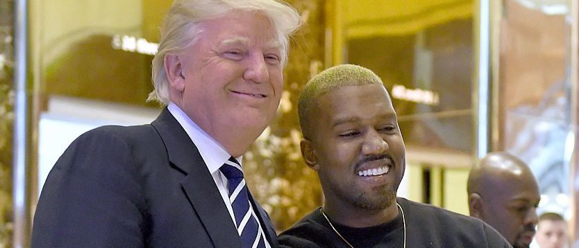Singer Kanye West and President-elect Donald Trump arrive to speak with the press after their meetings at Trump Tower December 13, 2016 in New York. / AFP / TIMOTHY A. CLARY (Photo credit should read TIMOTHY A. CLARY/AFP/Getty Images)