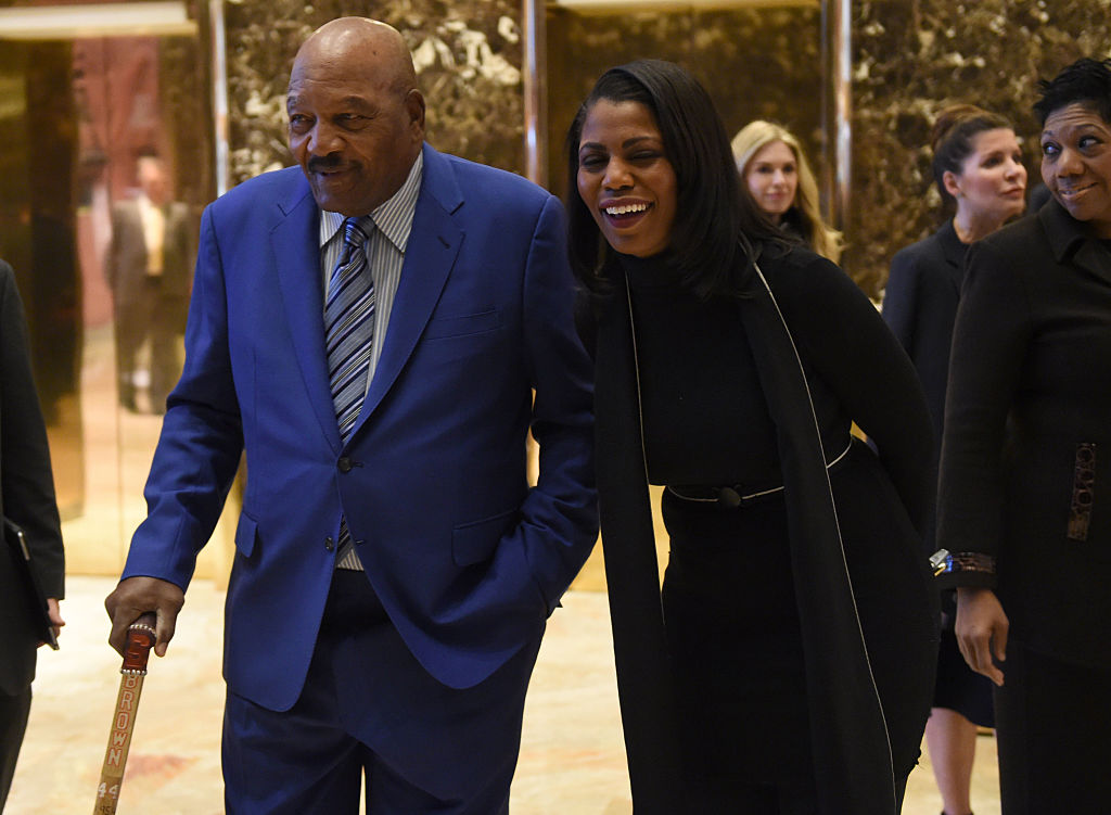 Football legend Jim Brown, and Reality television star and transition adviser Omarosa Manigault arrive at Trump Tower for meetings with President-elect Donald Trump on December 13, 2016 in New York. / AFP / TIMOTHY A. CLARY (Photo credit: TIMOTHY A. CLARY/AFP/Getty Images)