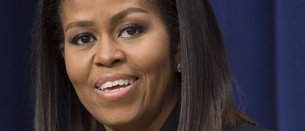 "First lady Michelle Obama speaks following a screening of the movie, ""Hidden Figures,"" in the Eisenhower Executive Office Building adjacent to the White House in Washington, D.C. on December 15, 2016. (SAUL LOEB/AFP/Getty Images)"
