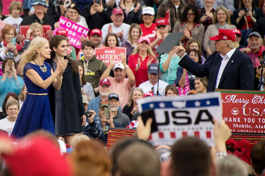 Kellyanne Conway and Hope Hicks appear onstage with Donald Trump (Getty Images)