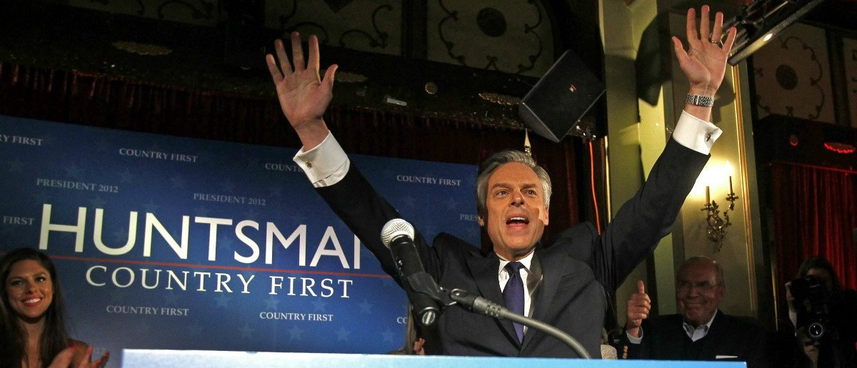 2012 Republican primary presidential candidate and former Utah Governor Jon Huntsman greets supporters as he takes the stage at his New Hampshire primary night rally in Manchester, New Hampshire, January 10, 2012. Huntsman finished in third place in the primary. REUTERS/Jessica Rinaldi