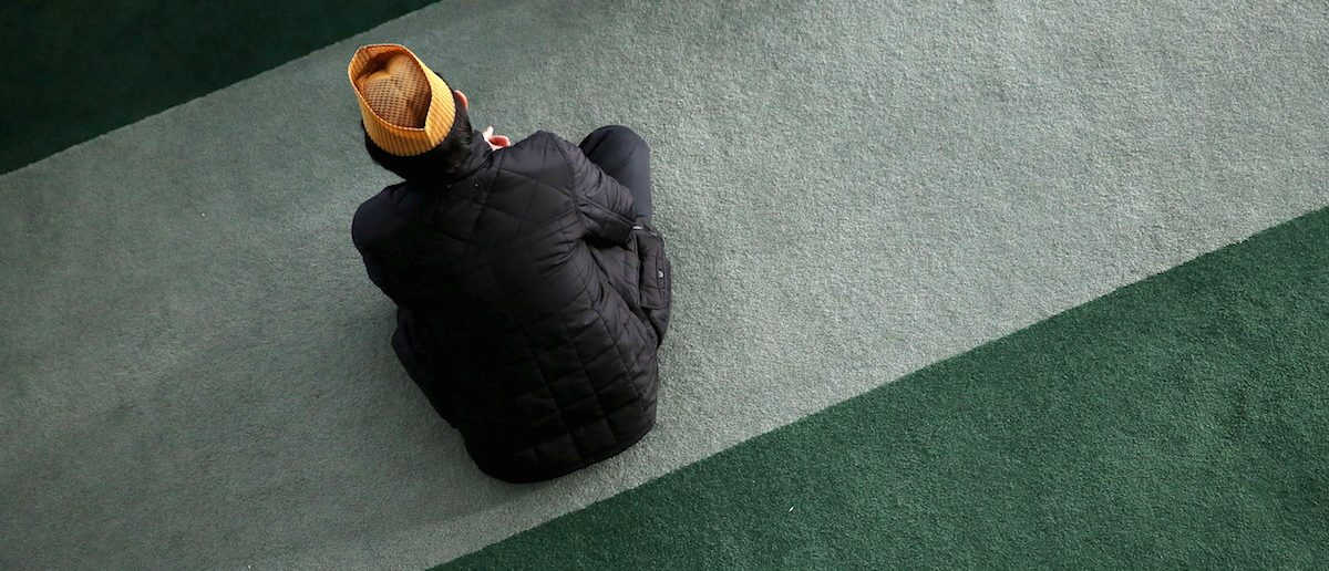 A Muslim attends Friday prayer at the Baitul Futuh Mosque in Morden, south London, Britain, November 20, 2015. REUTERS/Stefan Wermuth