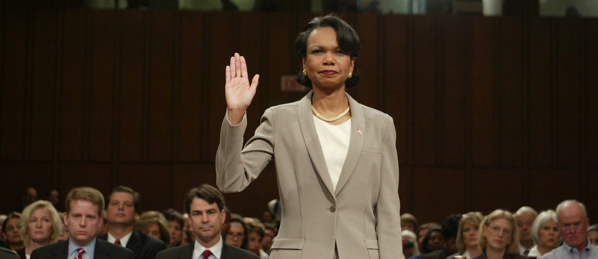 PICTURES OF THE YEAR 2004 - National Security Advisor Dr. Condoleezza Rice is sworn in to testify under oath before the 9-11 commission in the Hart Senate office building on Capitol Hill in Washington April 8, 2004. Rice testified before the commission in the highest profile national security testimony since the Iran-Contra affair nearly two decades ago, officials and analysts said. REUTERS/Larry Downing  MR/GMH - RTRIAW3