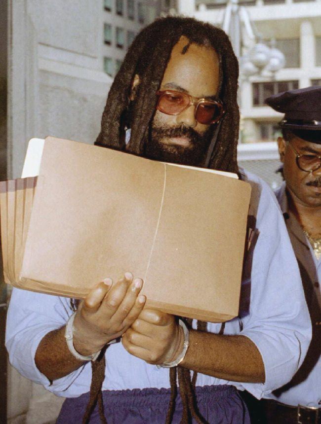 A federal judge overturned the death sentence of former Black Panther and radio journalist Mumia Abu-Jamal December 18, 2001, ordering a new sentencing hearing for the convicted killer of a Philadelphia police officer whose case has been championed by death-penalty opponents worldwide. REUTERS/Steven M. Falk/Files