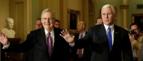 U.S. Vice President-elect Mike Pence (R) and Senate Majority Leader Mitch McConnell (R-KY) wave as they walk before their meeting on Capitol Hill in Washington, U.S., November 30, 2016.  REUTERS/Yuri Gripas