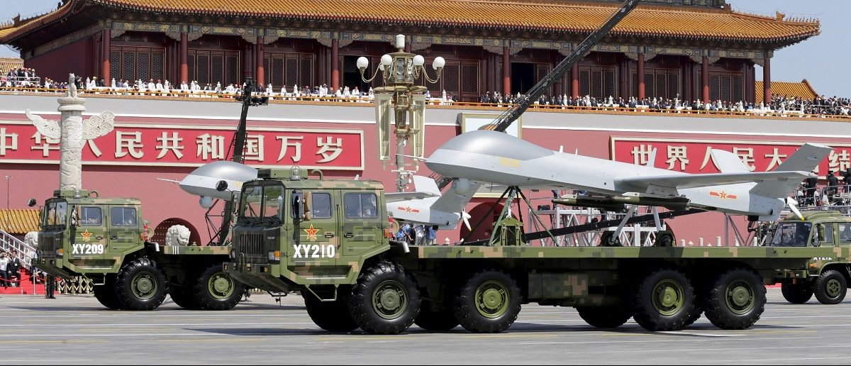 Military vehicles carrying Pterodactyl I unmanned aerial vehicles drive past the Tiananmen Gate during a military parade to mark the 70th anniversary of the end of World War Two, in Beijing, China, September 3, 2015. REUTERS/Jason Lee