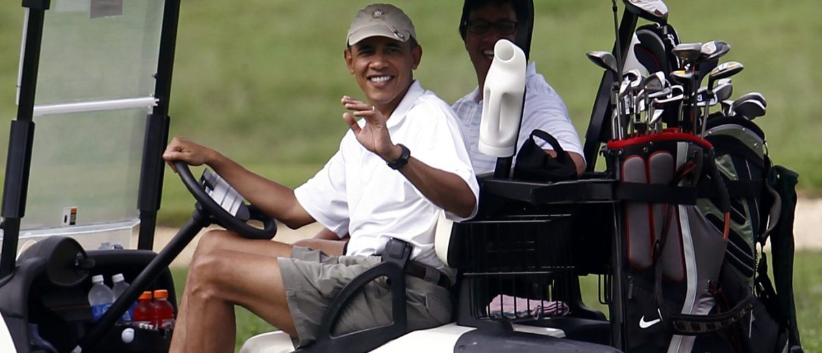 U.S. President Barack Obama waves from a golf cart at the Mid-Pacific Country Club in Kailua, Hawaii, December 28, 2010. With Obama is his friend Mike Ramos. REUTERS/Kevin Lamarque