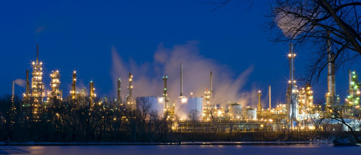 Oil and petroleum refinery along frozen Mississippi River in St. Paul Park Minnesota at night: Joe Ferrer/Shutterstock