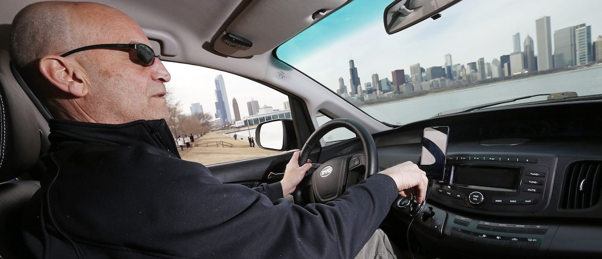 Uber driver Glen Snower sits in a BYD e6 electric car in Chicago, March 18, 2015. REUTERS/Jim Young