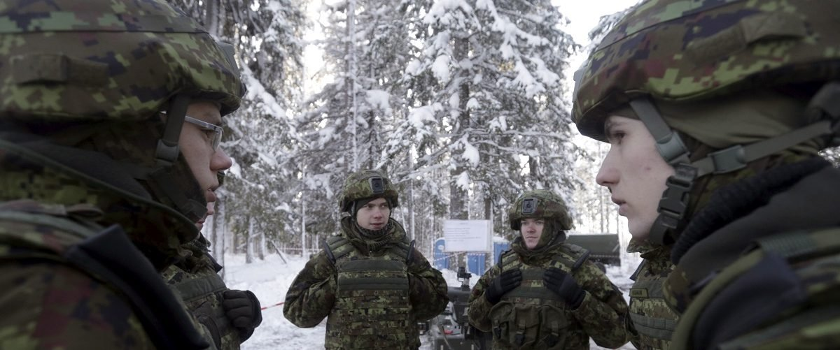 Estonian army soldiers speak before the first live fire exercise of their new Javelin anti-tank missiles in Kuusalu, Estonia, January 22, 2016. REUTERS/Ints Kalnins