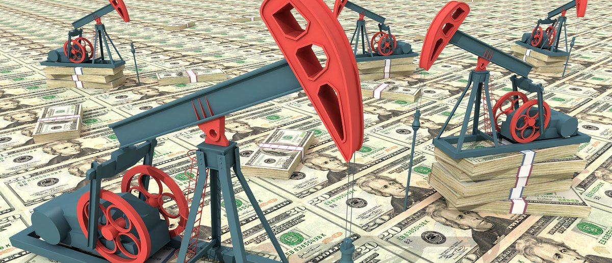 Oil pumps on dollar banknotes. Oil rig cash money Conceptual 3D illustration. (Shutterstock/AKOBCHUK VASYL)