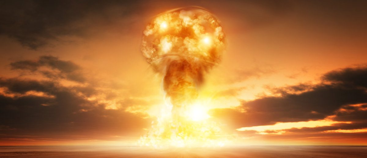 A modern nuclear bomb explosion in the desert. (Shutterstock.com/solarseven)