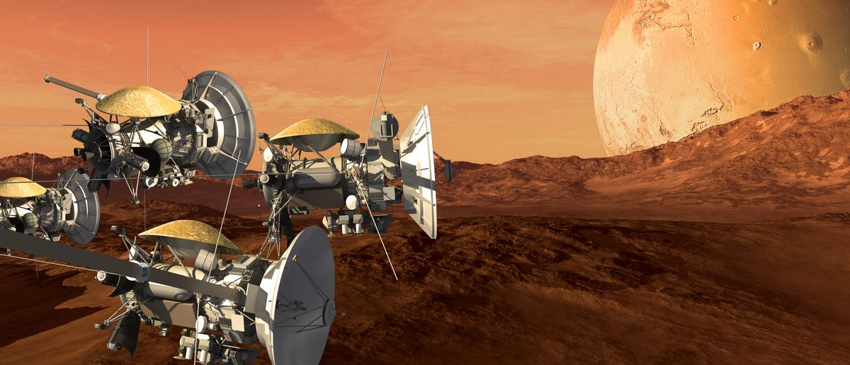 Unmanned spacecraft probes scouting a Mars like red planet, for space exploration and science fiction backgrounds.Elements of this image furnished by NASA. (Shutterstock/3000ad)