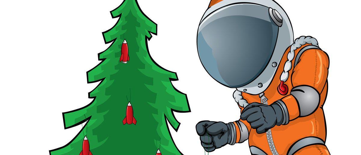 astronaut decorating the Christmas tree (Shutterstock/dohtoor)