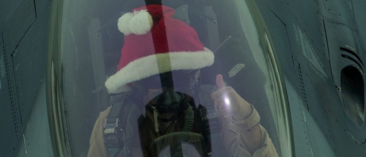 An F-16 pilots dons a red Santa hat as he refuels his aircraft mid-air. Source: Senior Airman Tyler Woodward/U.S. Department of Defense