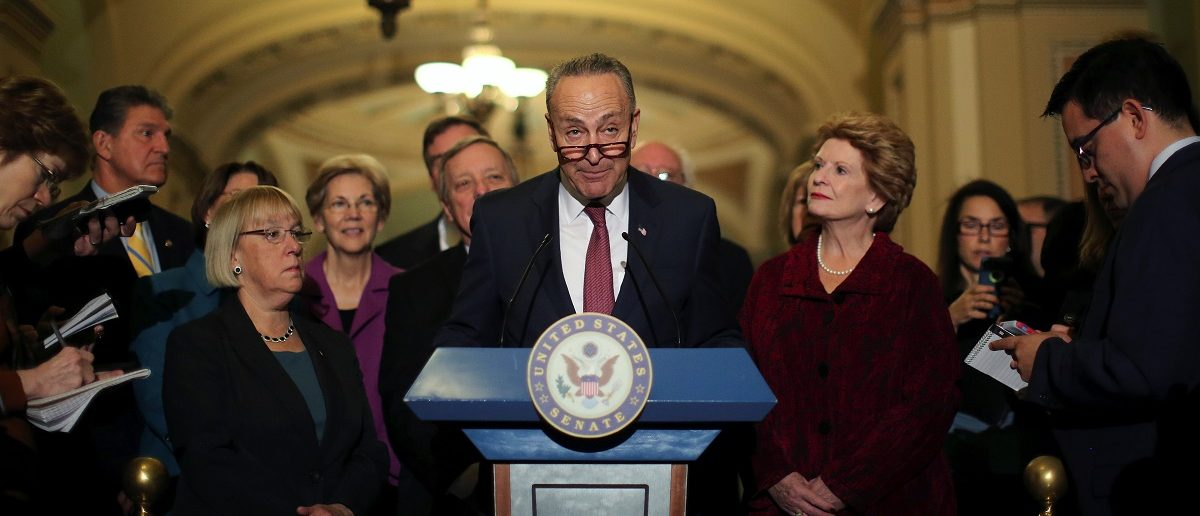 U.S. Senator Chuck Schumer (D-NY) talks to journalist after attending the Senate Democrat party leadership elections at the U.S. Capitol in Washington