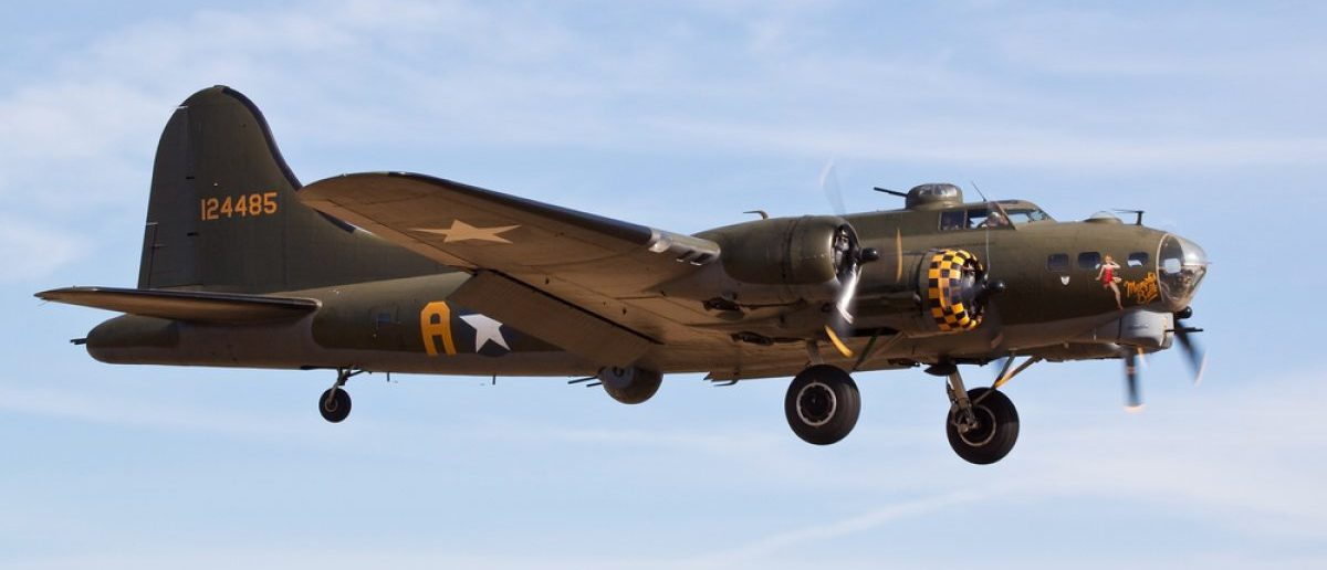A B-17G bomber comes in for landing in Cambridgeshire, UK. Source: IanC66/Shutterstock.com