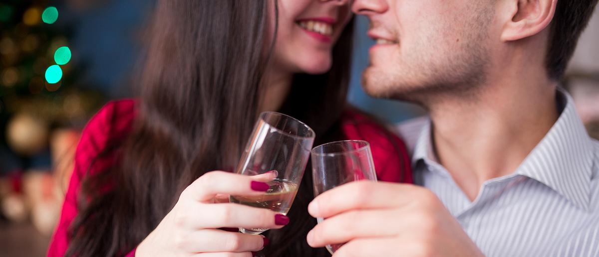 Couple sharing Christmas drinks (Credit: Elena Apanasenko/Shutterstock)