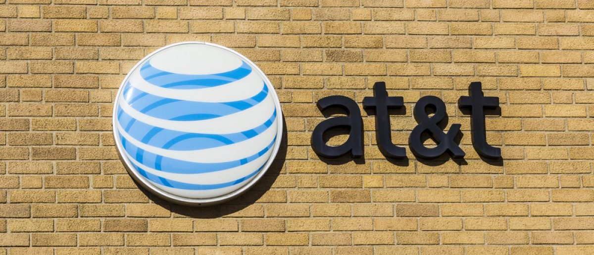 AT&T Corporate logo and signage on a downtown central office. [Shutterstock - Jonathan Weiss]