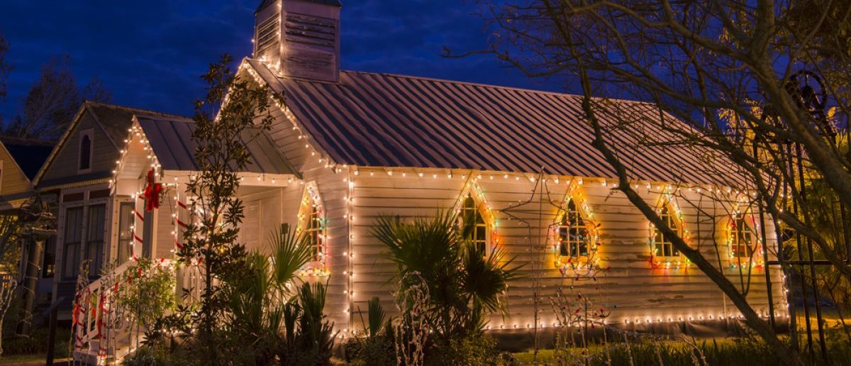 A church prepares for the Christmas season with lights and decorations.