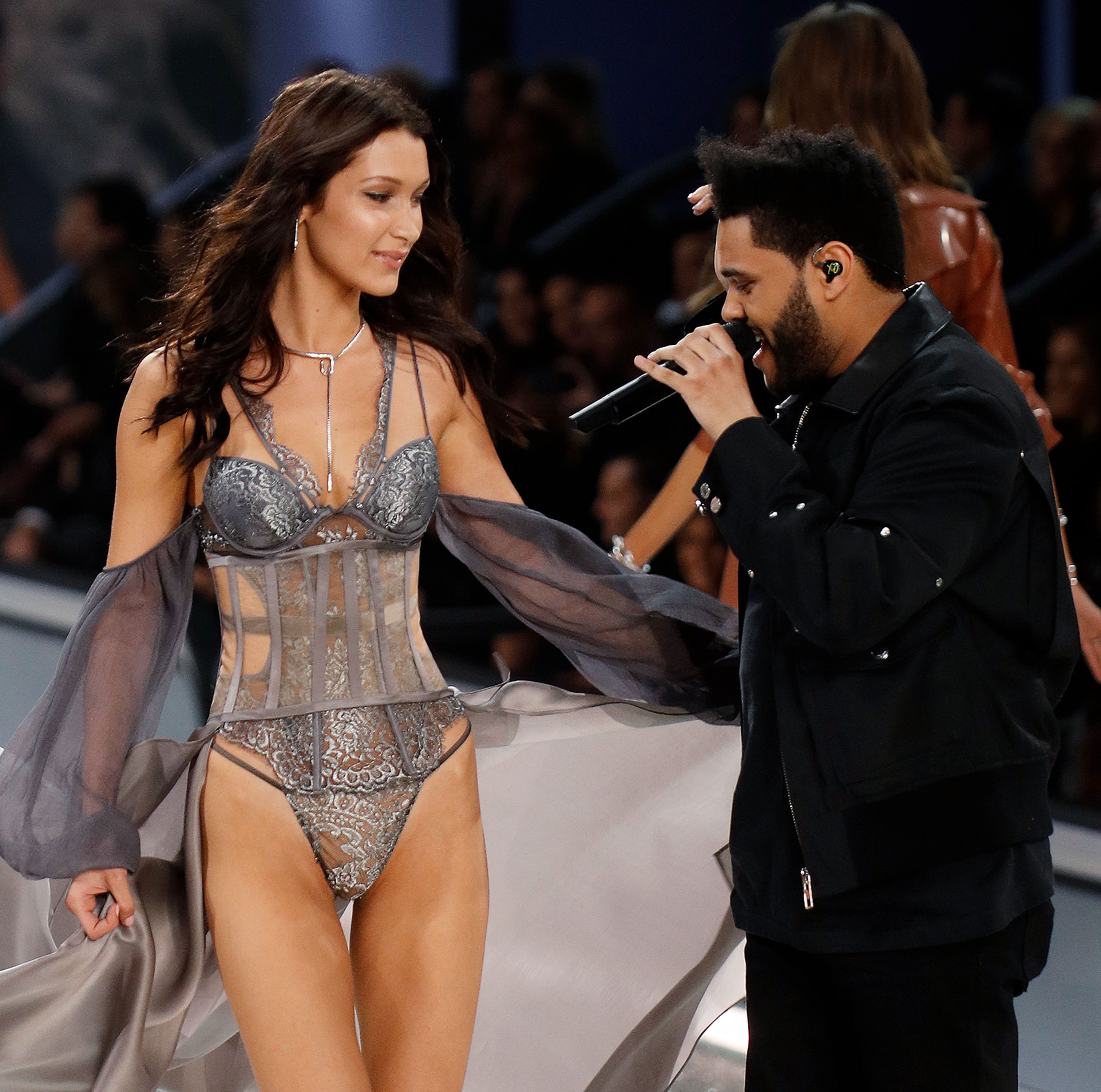 Bella Hadid and The Weeknd share a brief moment on the runway at the Victoria's Secret Fashion Show. (Photo credit: Splash News)