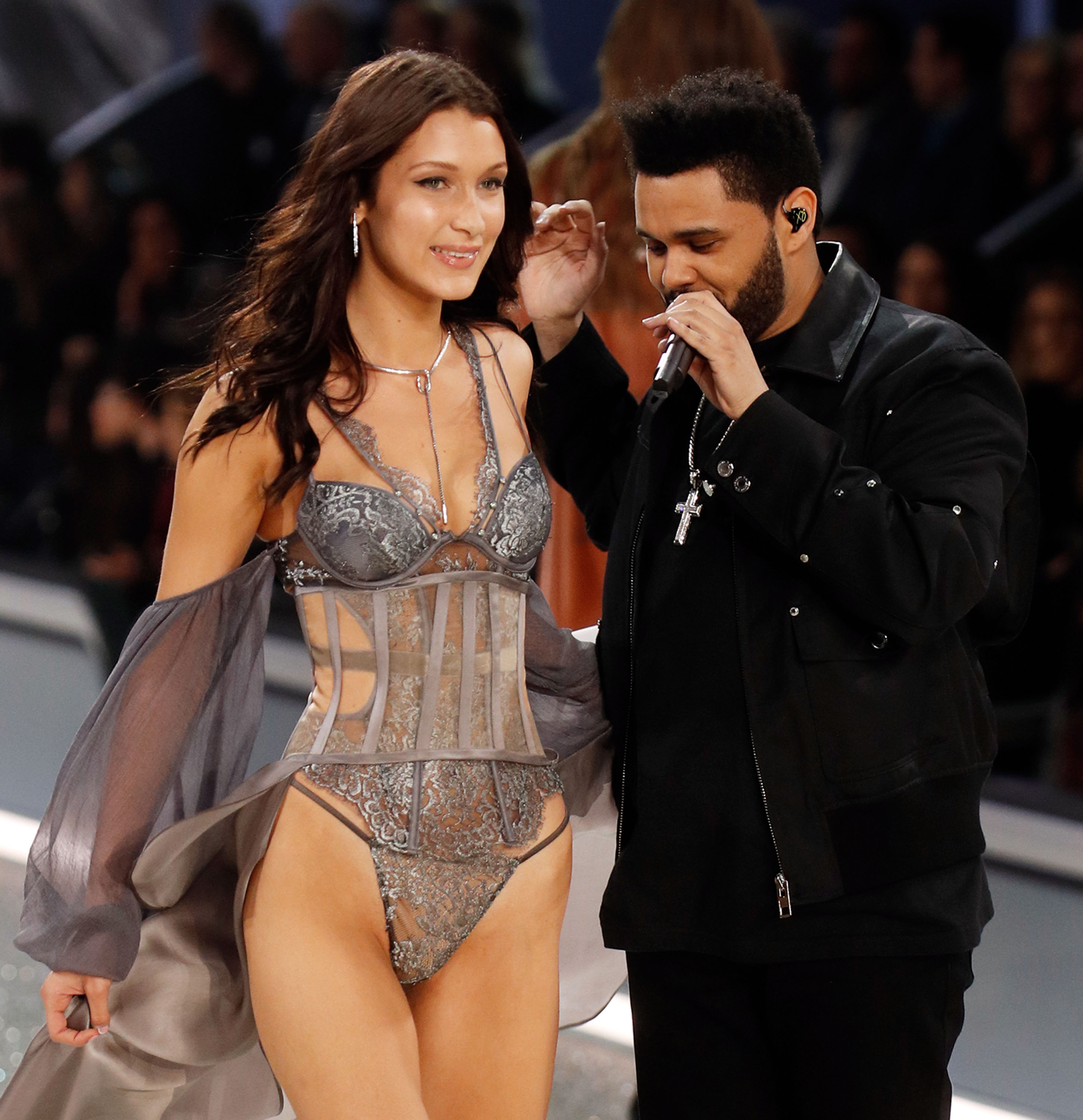 Bella continues down the runway leaving her ex-boyfriend looking after her. (Photo credit: Splash News)