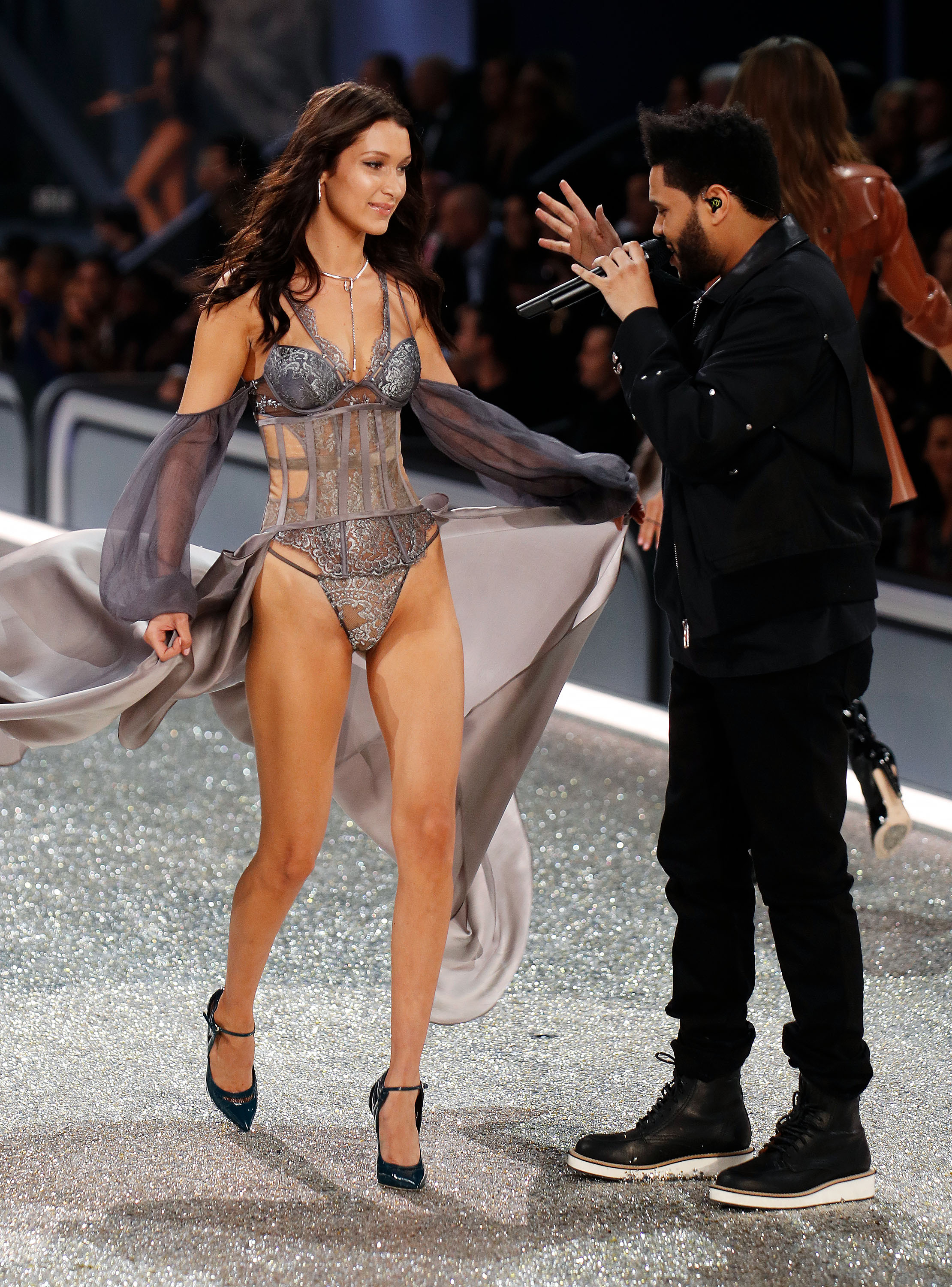 Bella approaches The Weeknd on her way down the runway. (Photo credit: Splash News)