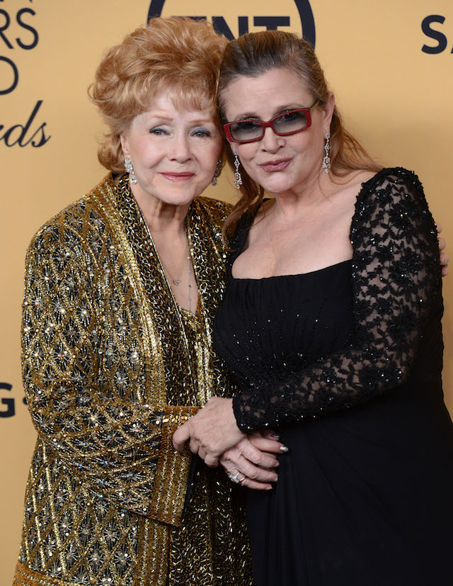 Debbie Reynolds and Carrie Fisher at the 21st Screen Actors Guild Awards held at Shrine auditorium in Los Angeles, California. Pictured: Debbie Reynolds, Carrie Fisher Ref: SPL1414422 281216 Picture by: Splash News Splash News a
