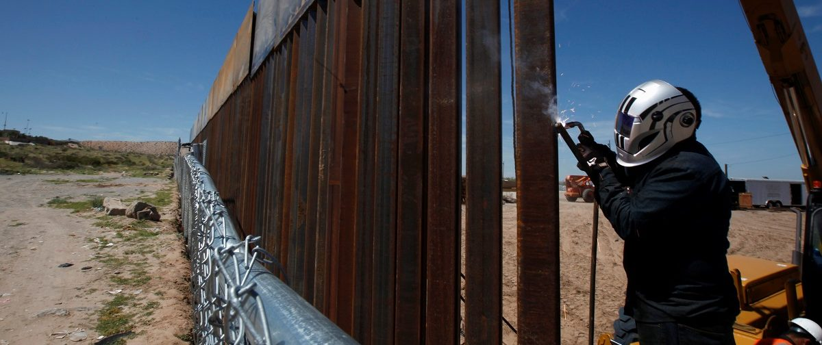 A U.S. worker builds a section of the U.S.-Mexico border wall at Sunland Park, U.S. opposite the Mexican border city of Ciudad Juarez