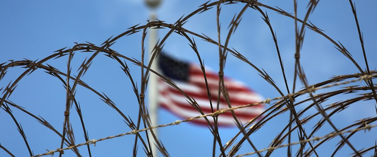 "Razor wire tops the fence of the U.S. prison at Guantanamo Bay, also known as ""Gitmo"" on October 23, 2016 at the U.S. Naval Station at Guantanamo Bay, Cuba. The U.S. military's Joint Task Force Guantanamo is still holding 60 detainees at the prison, down from a previous total of 780. In 2008 President Obama issued an executive order to close the prison, which has failed because of political opposition in the U.S. John Moore/Getty Images."