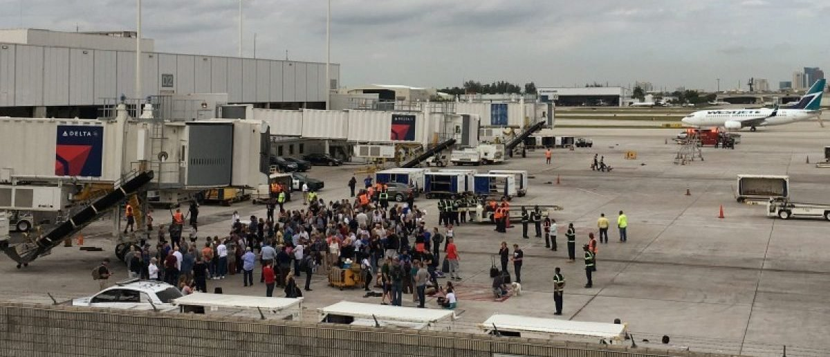 Travelers are evacuated out of the terminal and onto the tarmac after airport shooting at Fort Lauderdale-Hollywood International Airport in Florida